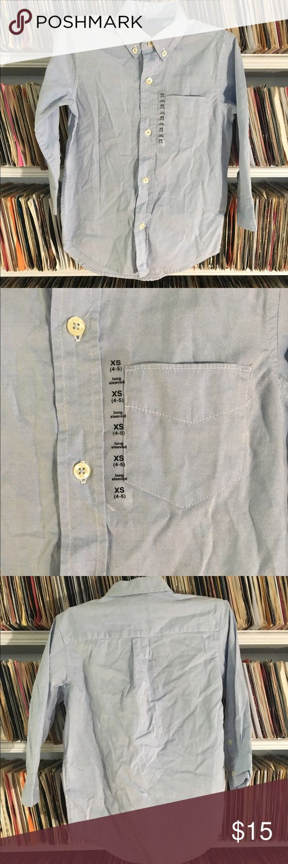 Gap Kids long sleeve oxford button down shirt blue This is a brand new blue button down shirt from the gap. It's a size XS 4-5. Its brand new with the original sticker but the hang tag was removed. Gap Shirts & Tops Button Down Shirts
