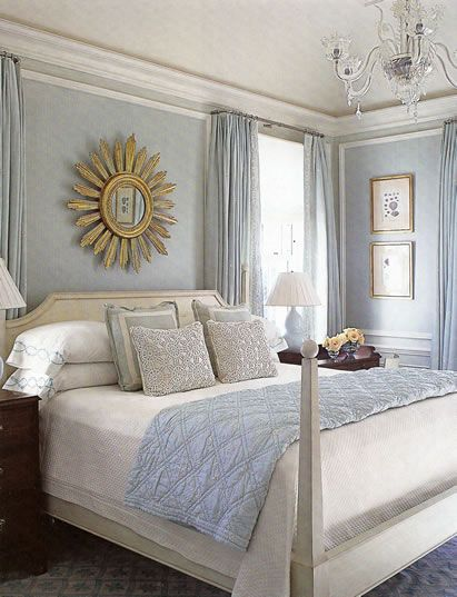 Bedroom with sunburst mirror by Phoebe Howard