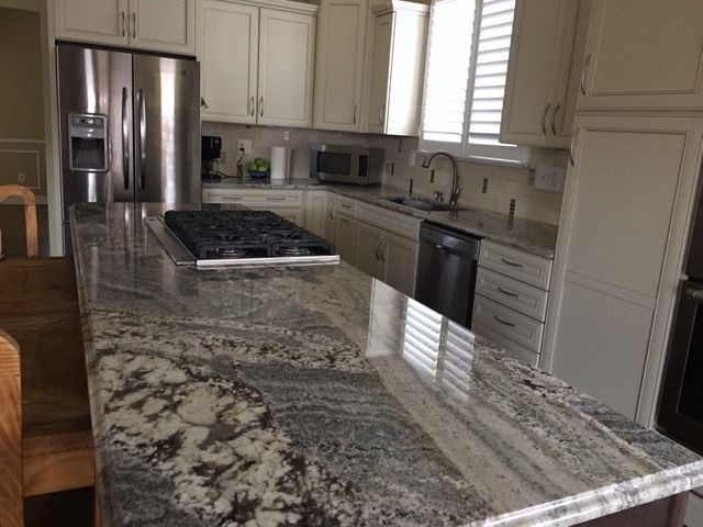 Arizona Tile Carries Monte Cristo In Natural Stone Granite Slabs Displaying  White, Silver, Yellow, Gold And Bluish Tones.