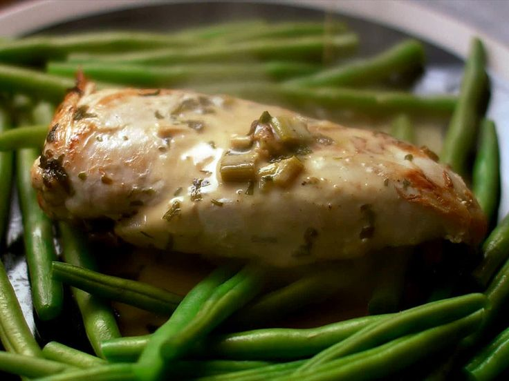 Tarragon Chicken - I filleted the chicken to cook faster and served with greens and a bit of white rice.  Delicious!