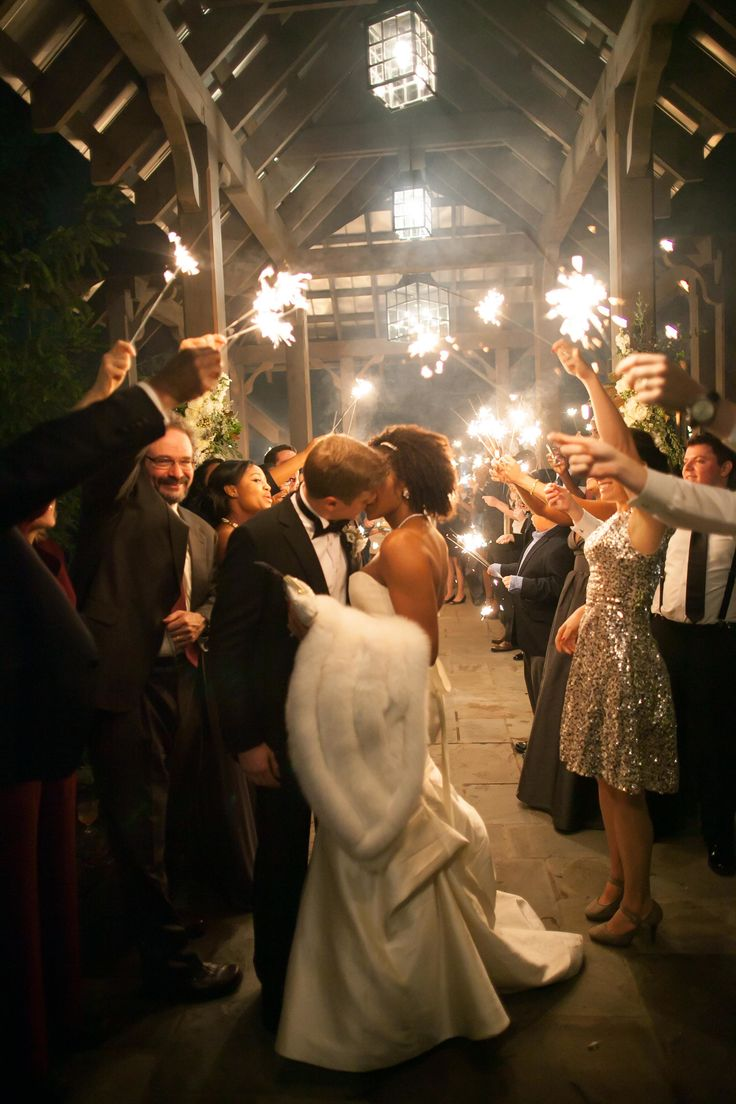 #sparklers Photography: Carrie Tabb - carrietabbphotography.com Read More: http://www.stylemepretty.com/little-black-book-blog/2014/06/23/modern-elegance-at-the-farmhouse-at-old-edwards-inn/