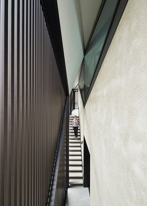 The faceted angles of the structure give the stairwell a dramatic effect.