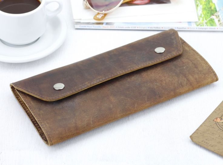 Our leather travel wallet has two side compartments for your travel documents and passport on one side and a generous zipped compartment on the other for coins, cards and notes. #leather #vintage #giftsforwomen