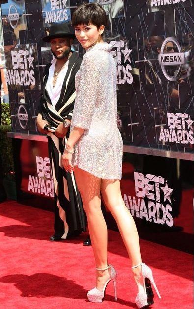 Zendaya on the 2015 BET Awards red carpet in a Nicolas Jebran shirtdress  and Roberto Cavalli platform sandals.