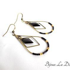 Boucles d'oreilles couleur bronze avec gouttes, losange et sequin noir                                                                                                                                                     Plus