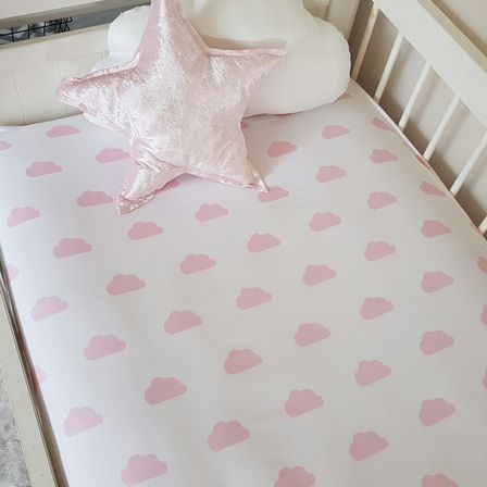 Soft Pink Clouds on White.   This fitted cot sheet is made from a beautiful quality organic cotton sateen which is extremely soft & also has a warm-to-the-touch feel, making sleepy time that much more cosy.    Elastic is enclosed around the entire sheet to ensure a snug fit.    Will fit a standard cot mattress including Boori & Mocka brands    Easy Care: warm or cold hand wash or gentle machine wash & line dry.