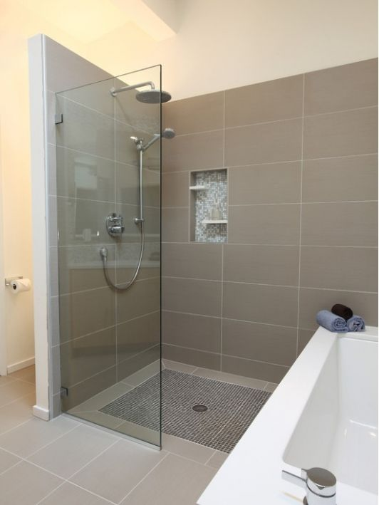 Grey large rectangle shower tile with decorative shelf in small tile