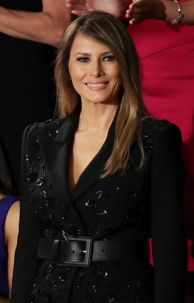 Melania Trump Photos Photos - First lady Melania Trump arrives to a joint session of the U.S. Congress with U.S. President Donald Trump on February 28, 2017 in the House chamber of the U.S. Capitol in Washington, DC. Trump's first address to Congress is expected to focus on national security, tax and regulatory reform, the economy, and healthcare. - Donald Trump Delivers Address to Joint Session of Congress