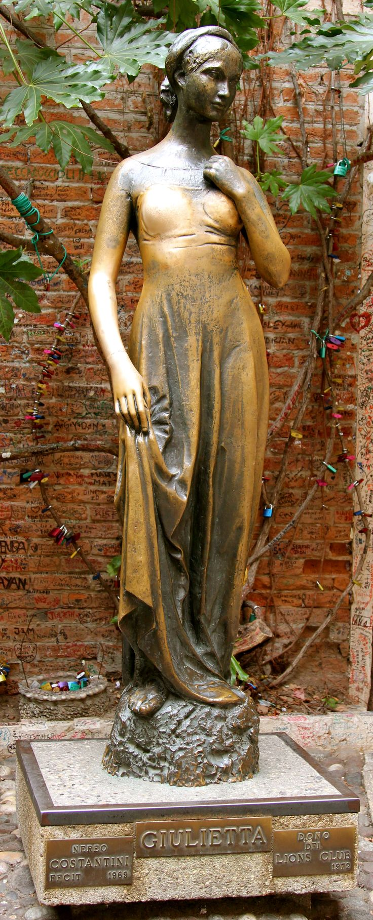Statue of Juliet in her Courtyard Verona, Italy Touching the right breast of the bronze statue of Juliet in the small courtyard will bring luck to all who are trying to find their true love.