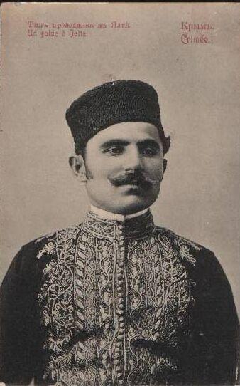 Crimean Tatar in festive/ceremonial outfit.  Crimea, ca. 1900.