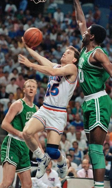 Cleveland Cavaliers guard Mark Price (25) drives inside Boston Celtics Robert Parish, right and Larry Bird, background, for a first quarter lay up during game seven of the NBA Eastern Conference Semifinal Game at the Richfield Coliseum, Sunday, May 17, 1992, Richfield, Ohio. (AP Photo/Mark Duncan)