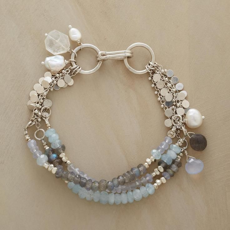 """GALLERY BRACELET Item No. 57672 $465.00 The watery hues of a British masterpiece inspired Naomi Herndon's hand strung strands featuring AQUAMARINE, LABRADORITE and CHALCEDONY. Sterling silver; hook clasp. Exclusive. 7-1/2""""L."""