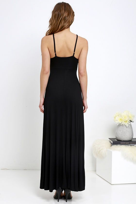 Cute and comfy is what the jersey knit Fame to Claim Black Maxi Dress is all about! The darted bodice has a plunging neckline decorated by crisscrossing bands, and is supported by adjustable spaghetti straps. Sweeping maxi skirt (with side slit) completes the casual but chic silhouette.