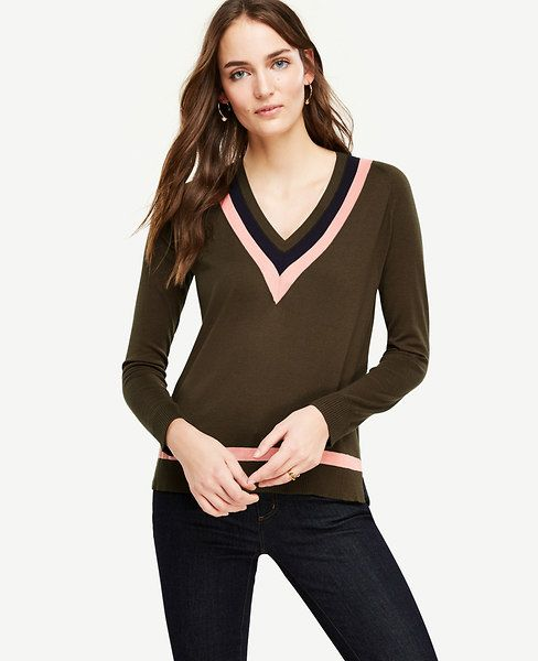 "In a refined silk and cotton blend, clean stripes lend modern definition to this timeless classic. V-neck. Long sleeves. Side slits. 25 3/4"" long."
