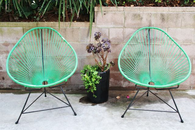 Acapulco chairs in minty green.