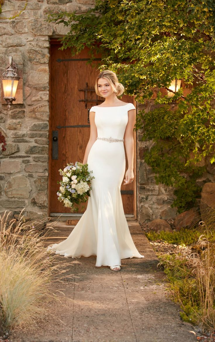 This boat neck wedding dress with cap sleeves and a plunging back from Essense of Australia is perfect for a dramatic entrance - and exit!