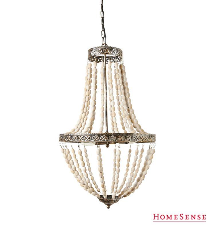Make a grand entrance with a beautiful beaded chandelier. #fall #style #decor #cream #lighting #solutions / Impressionnez vos invités grâce à ce chandelier perlé. #automne #style #déco #crème #luminaires #solutions  Enter Contest: http://www.HomeSense.ca/HomeSenseStyle Participer: http://www.homesense.ca/fr/pinterest-contest.asp  #HomeSenseStyle