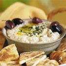 Baba Ghanoush; This creamy mixture is made with smoky, fire-roasted eggplant, tahini (sesame-seed paste), lemon juice and plenty of minced garlic. Serve with warmed pita wedges or crackers.
