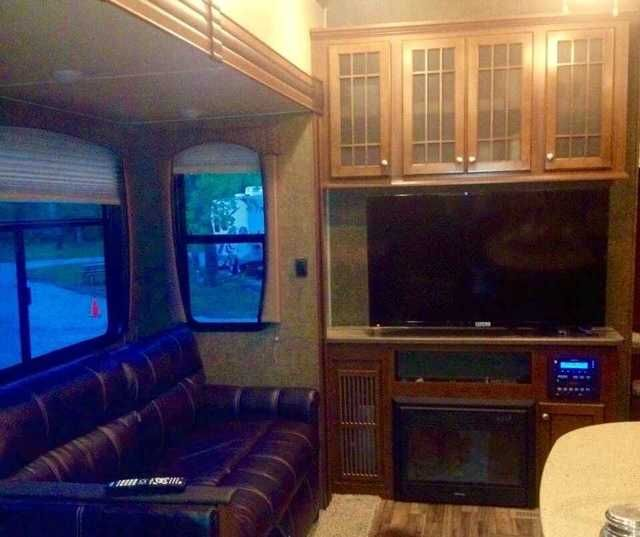 2014 Used Heartland Silverado 38QBS Fifth Wheel in Iowa IA.Recreational Vehicle, rv, FOR SALE: Like new 2014 Heartland Silverado 38 QBS, 5 slides, hydraulic landing gear, along with outdoor kitchen with 2 burner gas stove, sink and mini fridge. Master bedroom with king sized bed, w/d hookup and bathroom. Rear bunk house sleeps 4 with bunk beds, trendle bed, plus plenty of storage, along with a second half bath. Living room with gas fireplace, big screen TV and surround sound audio for…