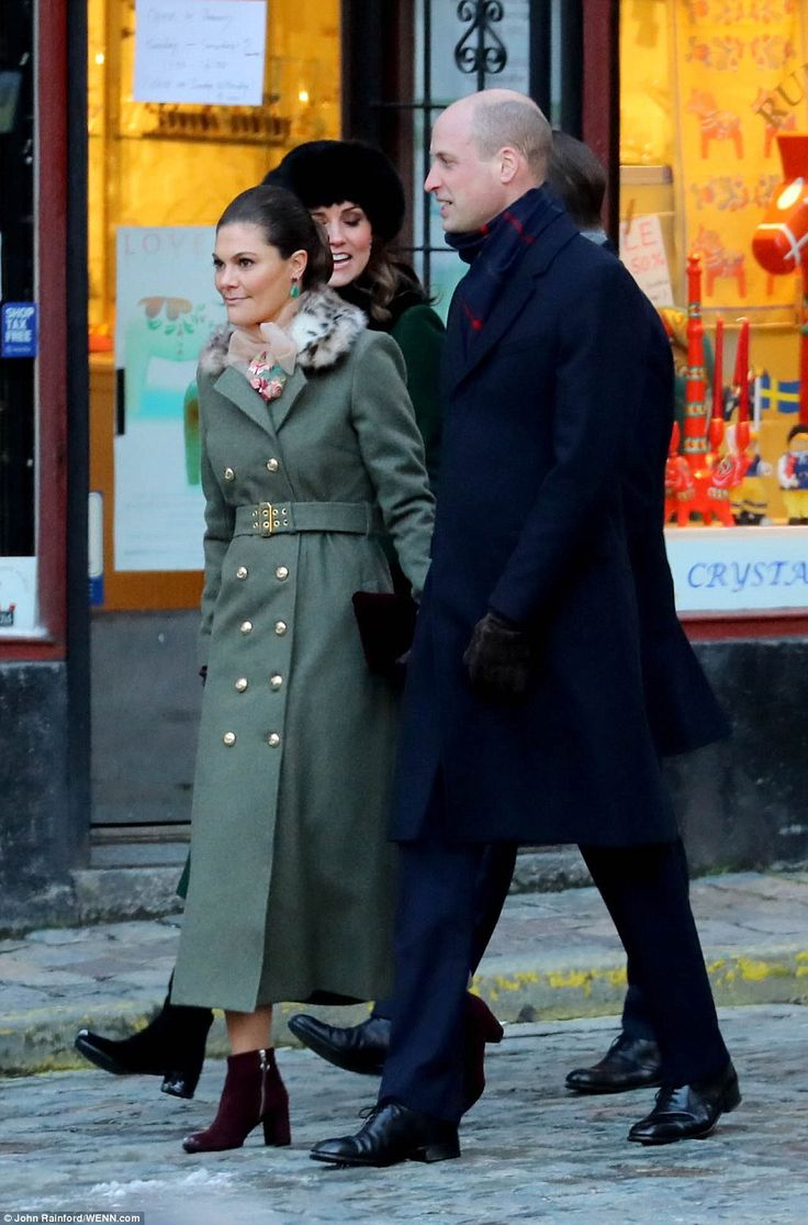 Crown Princess Victoria also opted for a green coat, in a lighter shade than Kate's, which she teamed with red ankle boots