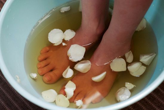 water infused with chamomile tea and rose petals pedicure soak