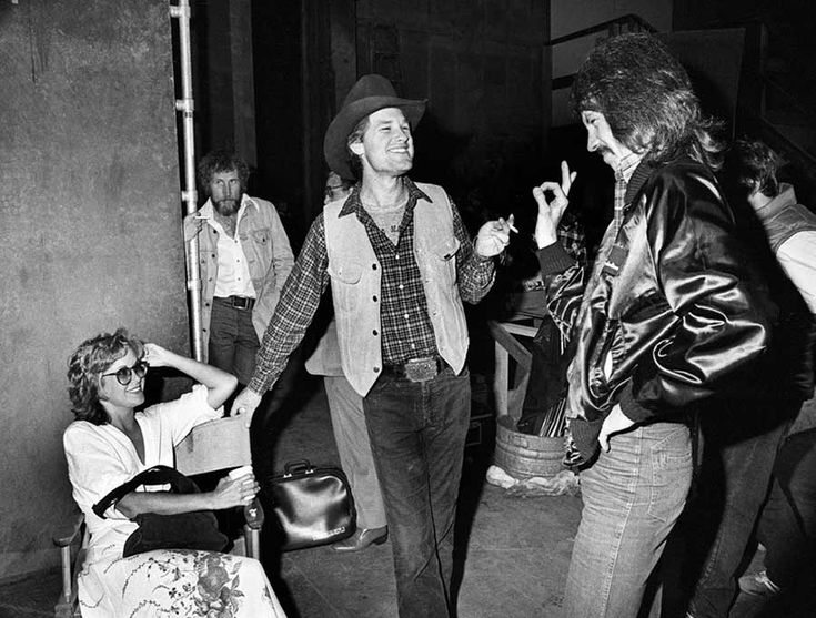 Kurt Russell and his wife Season Hubley visiting the set of The Fog to talk with John Carpenter about ideas for Escape from New York