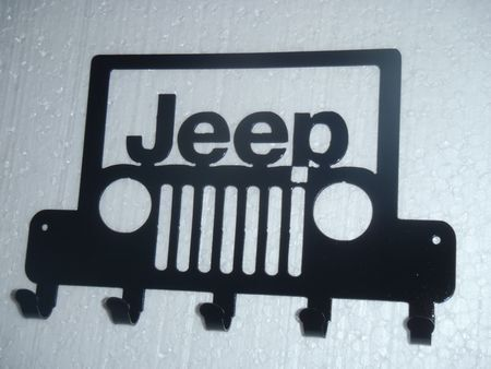 This is a Plasma Cut Key Rack with the Jeep logo. Measures 10 in length (25 cm)  This metal art is an ideal gift idea for your friends. With this piece