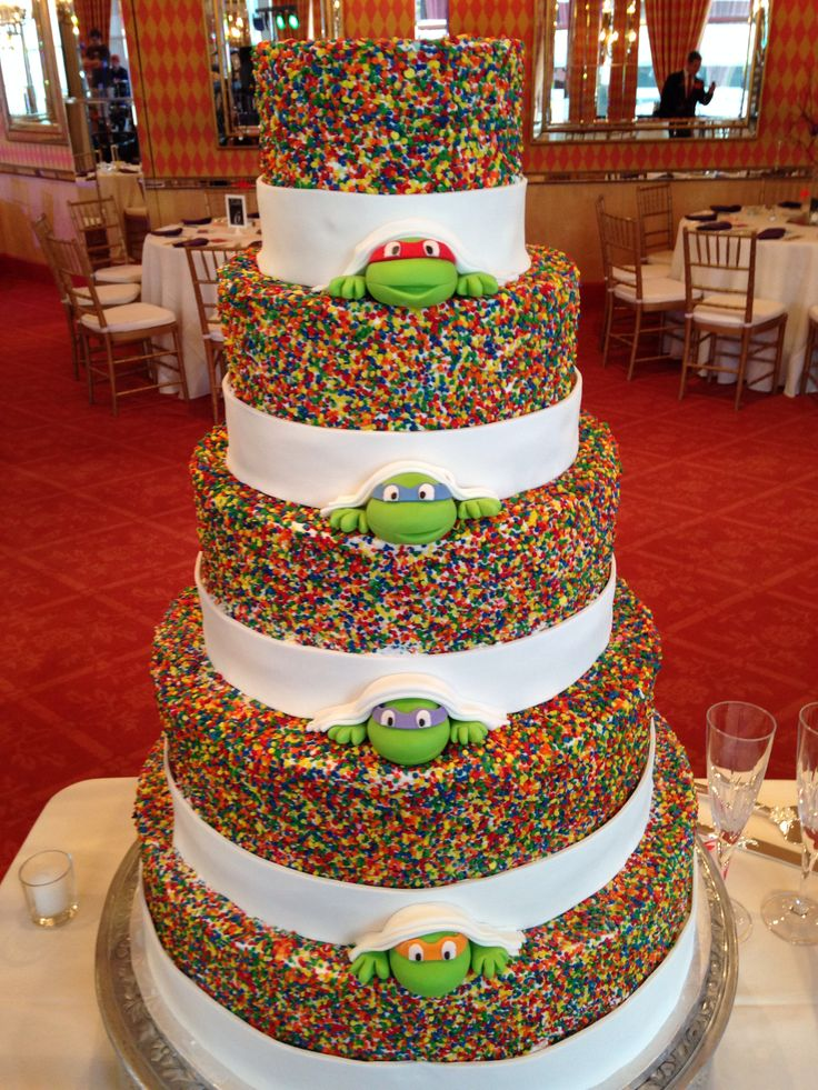 Our Ninja Turtle sprinkle wedding cake. Cake by http://www.thecakeguys.com/, Ninja Turtle from http://www.etsy.com/shop/SweetTreatsbyJess