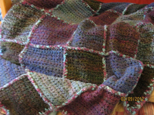 Bad photo of a really fuzzy uneven edged blanket for kid #1.