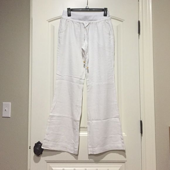 White beach pants White beach pants, stretch waist, with tie front, never worn but were ordered and didn't have tags when they arrived. Pants