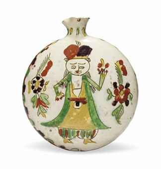 A KUTAHYA POTTERY PILGRIM FLASK WEST ANATOLIA, 18TH CENTURY Of flat-sided circular form with slightly everted cylindrical neck and pinched spout, the white ground decorated in red, manganese, yellow and green, one side with a stylised figure surrounded by floral sprays, the other with a loose palmette design surrounded by leaves, small rim chips, otherwise intact 7½in. (19cm.) high