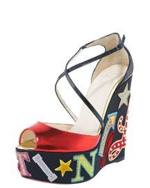 """Celebrate 20 years of Christian Louboutin with this exuberant wedge sandal, which spells out the designer's name in distinctive letter patches.""- Bergdorf Goodman    BEYOND AMAZING! Mother may I?"
