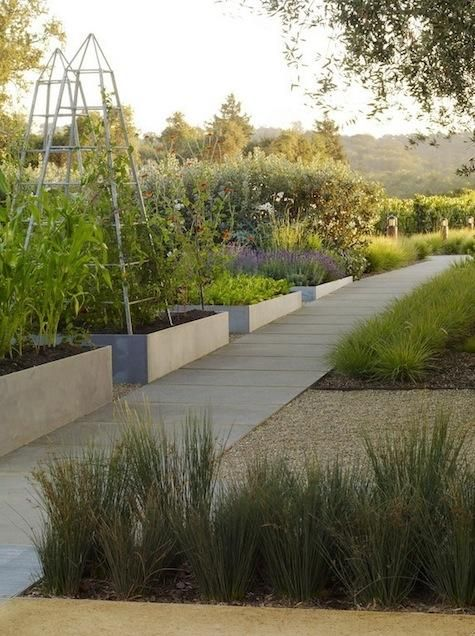 Low-maintenance planting scheme with flower beds in custom zinc boxes displayed in a grid.