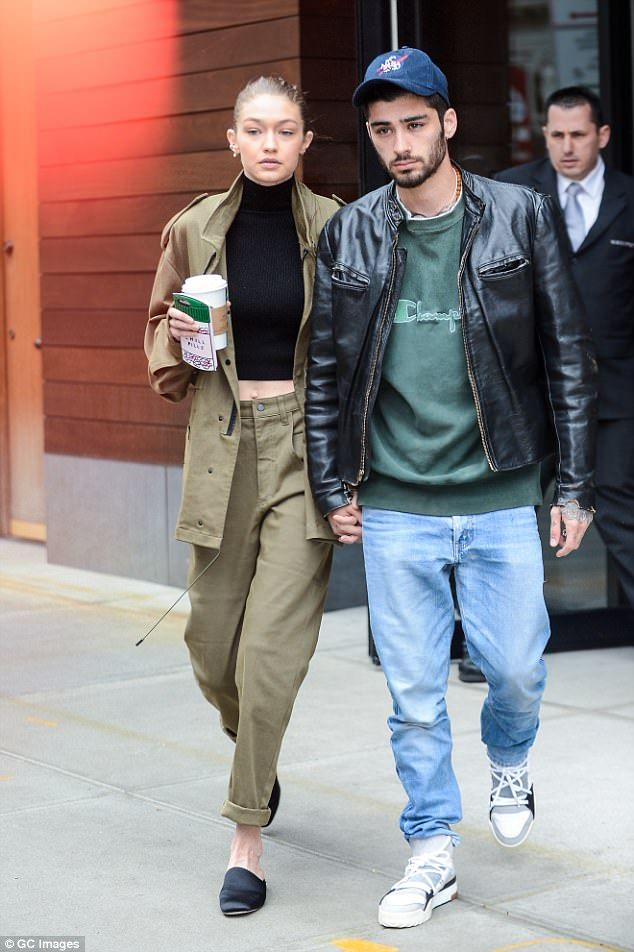 Stepping out: Gigi was in a khaki green two-piece, with black satin slides...