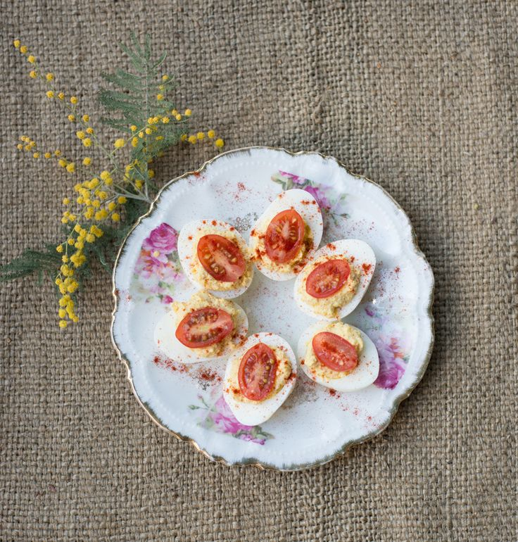 Cute Superbowl Party idea: Hummus-Tomato Deviled Eggs via The Forest Feast