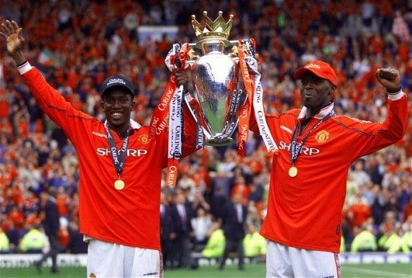 Andy Cole and Dwight Yorke celebrate United's Premier League win in1998/99