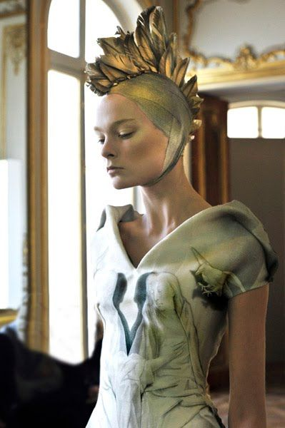 Head dress on Alexander McQueen dress.