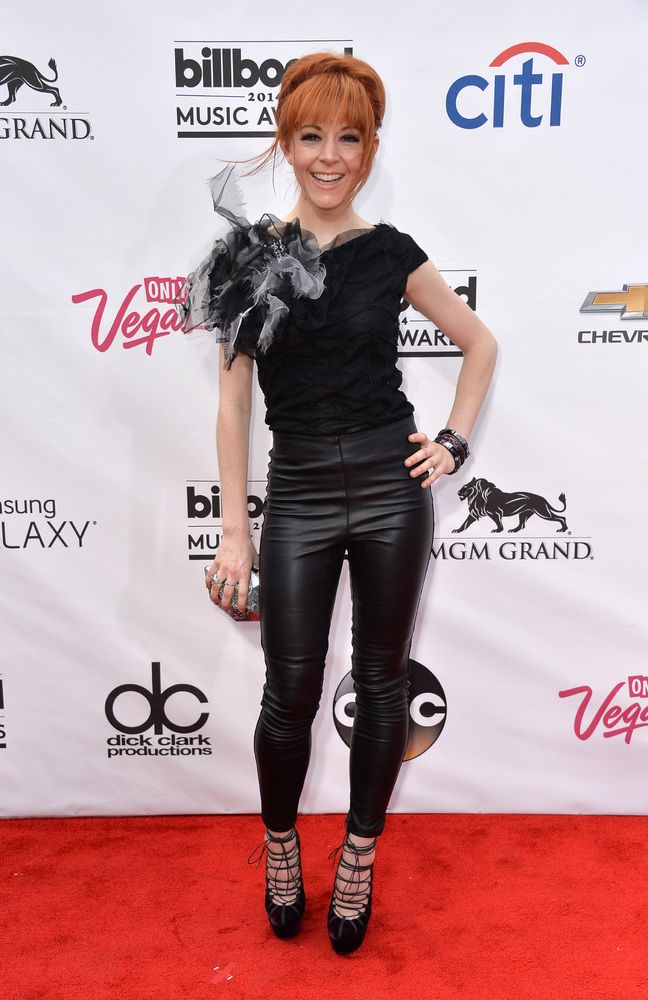 Lindsey Stirling -  Billboard Music Awards 2014: Stars Heat Up The Red Carpet.  Lindsey Stirling is an American violinist, dancer, performance artist, and composer. She presents choreographed violin performances, both live and in music videos found on her YouTube channel, Lindseystomp, which she introduced in 2007. (source: wikipedia.com, huffingtonpost.com)
