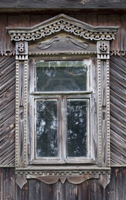 Carved window in old russian wooden country house Stock Photo
