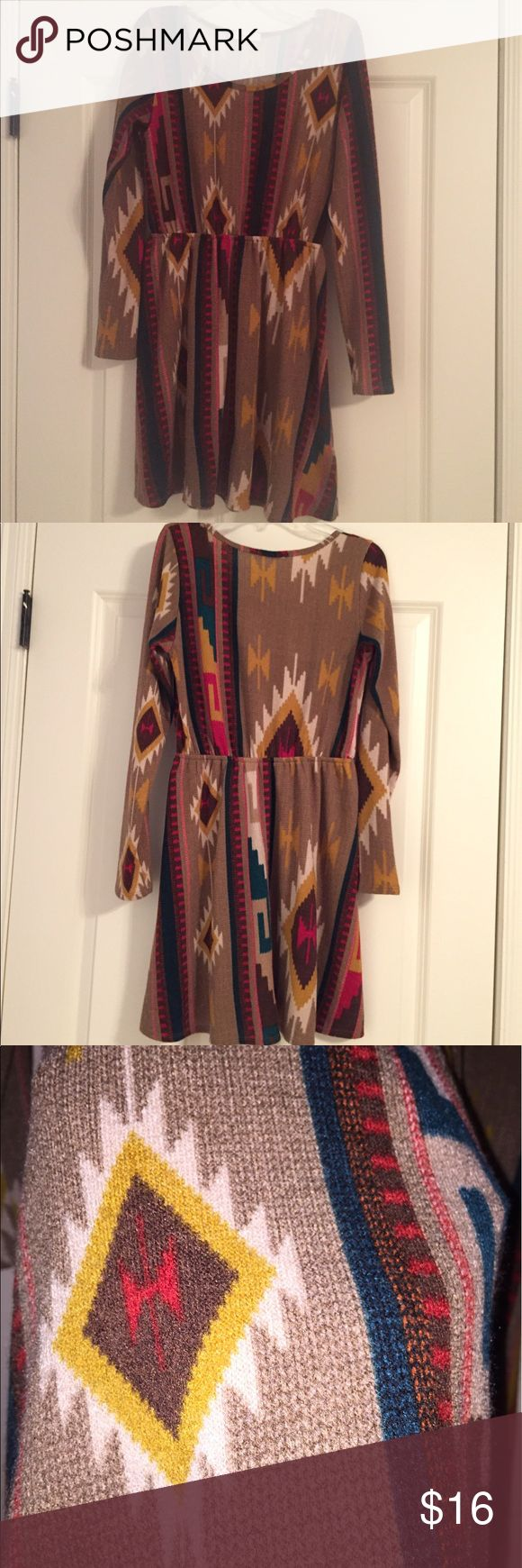 Everly Sweater Dress This is a size small dress!! The aztec print is perfect for any occasion and perfect for pairing with colored jewlery! The dress is made of a comfy sweater material. Worn no more than a few times! Everly Dresses Long Sleeve