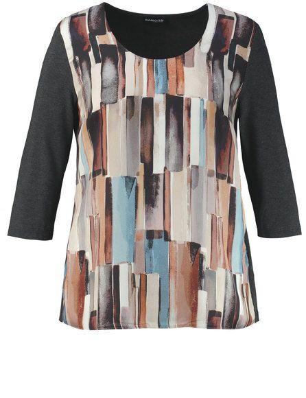 De vrouwelijke shirt met vloeiende, ondoorzichtige verdubbelde blouse voorkant combineert mode met aangenaam gevoel. De effectieve print kan een act v...