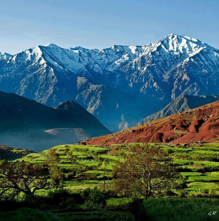 Atlas Mountains, Morocco. The Atlas Mountains range across the northwestern stretch of Africa extending about 2,500 km through Algeria, Morocco and Tunisia. The highest peak is Toubkal, with an elevation of 4,165 metres in southwestern Morocco. (V)