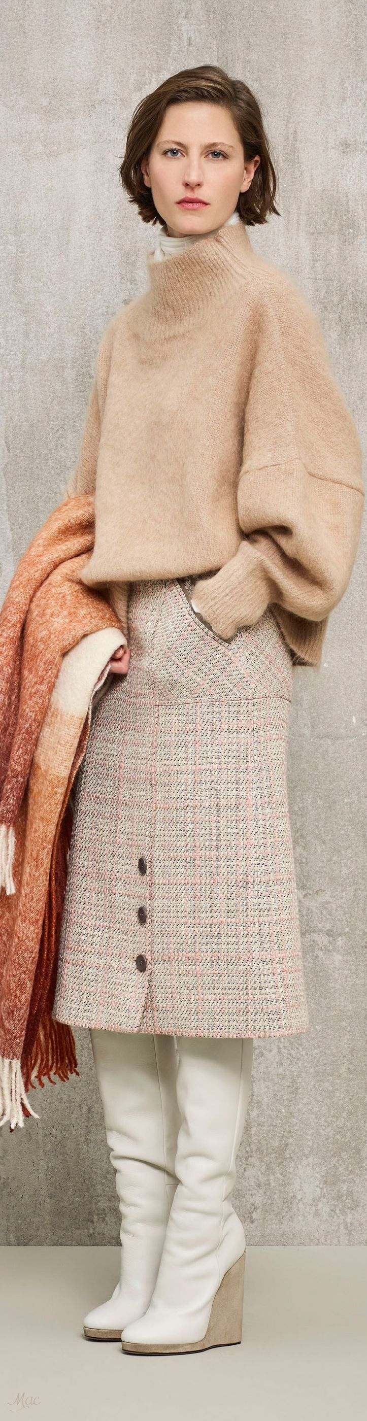 White boots+ plaid skirt+ beige oversize sweater+ orange coat.
