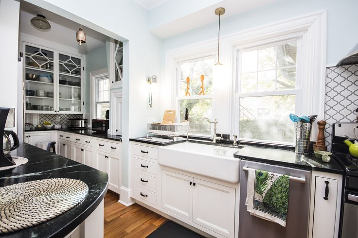 1896 East side of Providence,RI kitchen remodel. Keeping the period feeling with a modern twist has been achieved with Candlelight Cabinetry white inset cabinets. Soapstone countertop,Danze Opulence Fucet ,Kohler farmhouse sink  Top Knobs trunk pull.  Black hardware. White farmhouse sink.   #RIKitchens #Whitecabinets #historicalremodel #insetcabinetry #customcabinets   Designed by Craig Couture Cypress Design Co 401-438-5105  #NKBA30_30   Installation East Side Construction (401) 434-6600