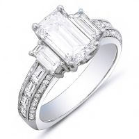 Truly elegant beauty can be found in this 4.23 Ct. diamond engagement ring. The classic emerald cut diamond would be adored by any woman. Meanwhile, each side of the center stone features baguette cut diamonds while additional Baguette and Round cut diamonds line the shank in channel and micro pave set. This ring is available in 14K white or yellow gold, 18K white or yellow gold or platinum.