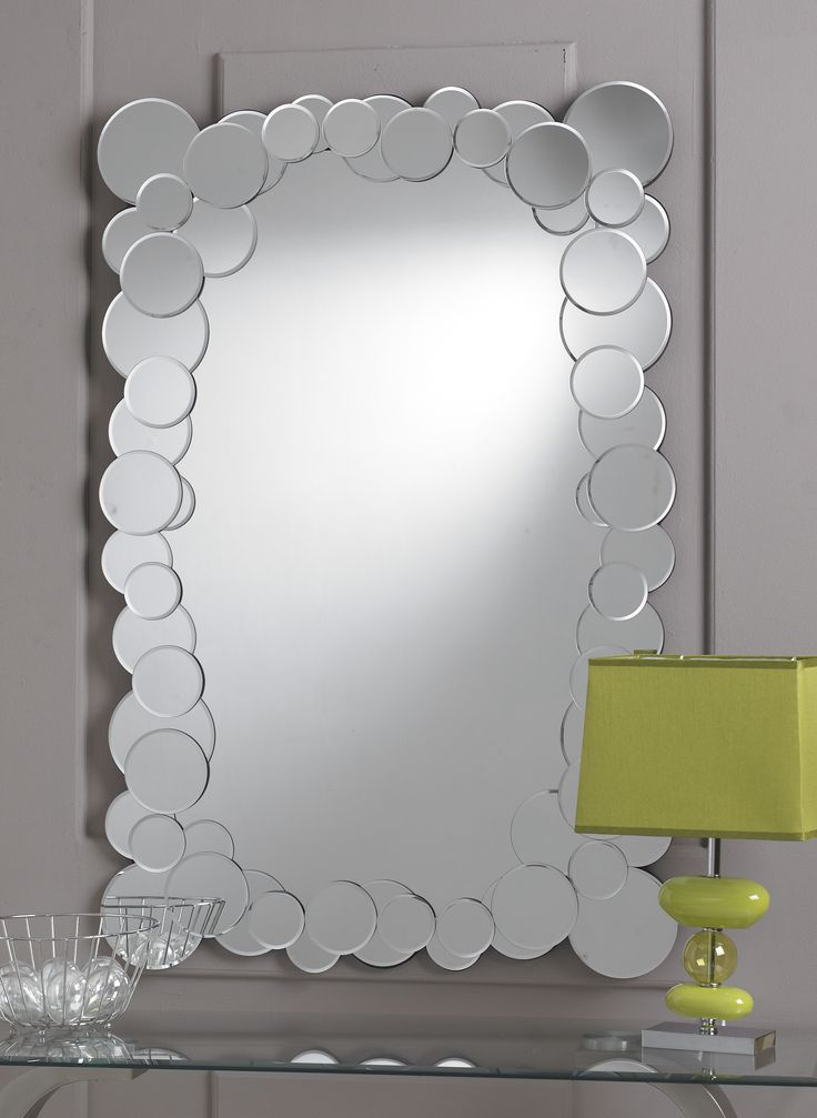 A elegant an unique wall mirror, the funky styled Bubble Mirror gives a stylish look to your home. The quirky and fresh look of the Bubble Mirror gives a modern eyecatching style. The border of the Bubbles Mirror is made up of multiple smaller round mirror pieces, scattered at random, giving a bubbles effect. This is a fun circular Bubbles Mirror which has a main central section with a narrow border. http://www.chicconcept.co.uk/4416-bubble-mirror--5055157621116.html