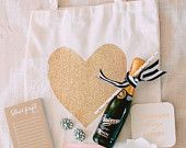 This tote is the perfect addition to any bachelorette party, bridal party event, gift bag or favor bag. Fill it with essentials for a girls getaway trip for the weekend with hangover supplies, or bachelorette supplies. This tote also makes a classy and elegant way to ask the special ladies in your life to be a part of your wedding as a bridesmaid or maid of honor.