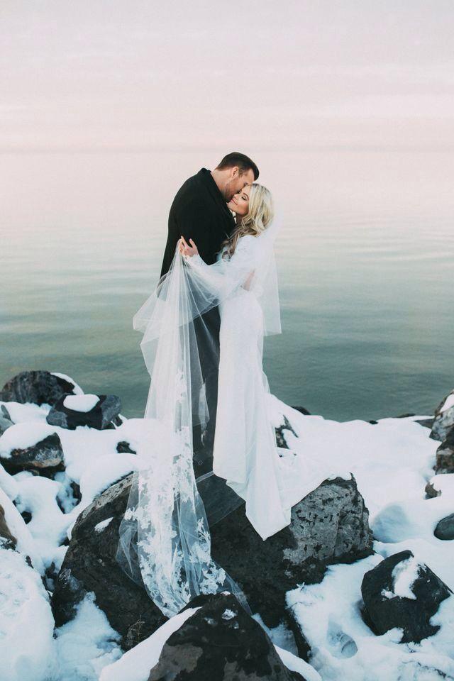 A snowy seascape wedding photo. Simply Stunning.