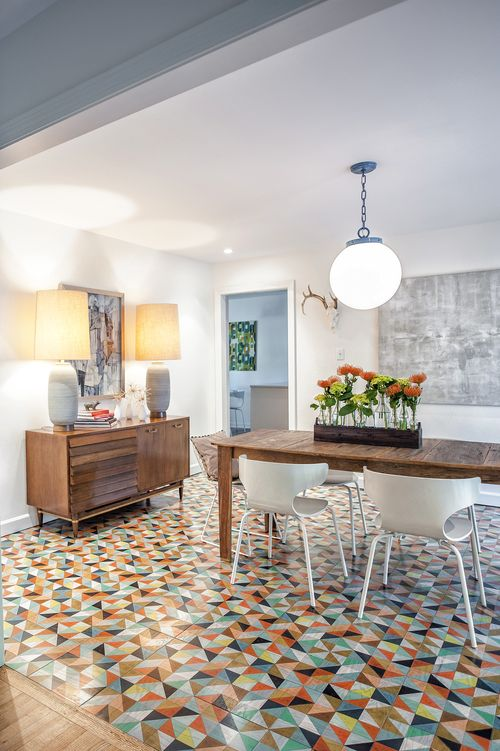 Not this design, but I love the idea of having a painted wood panel floor for the dining area of the studio.