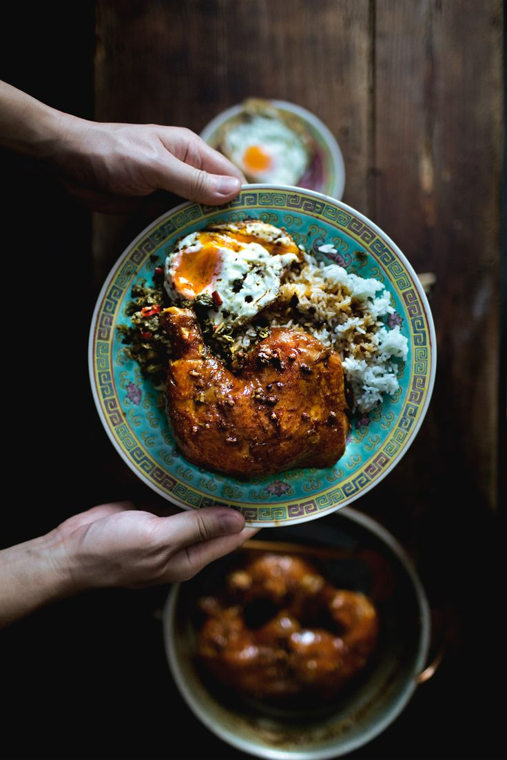 Braised chicken, fried chili capers, and and egg, all topped over a plate of rice. Looks insanely delicious.